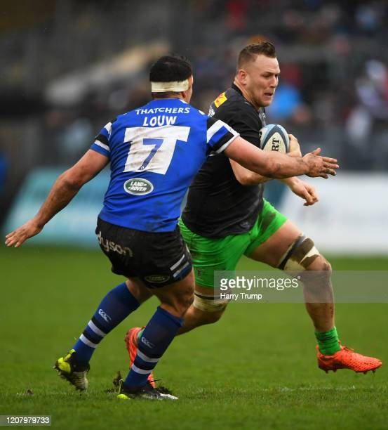 Alex Dombrandt of Harlequins looks to break past the tackle from Francois Louw of Bath Rugby during the Gallagher Premiership Rugby match between...