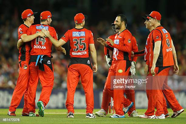 Alex Doolan and Fawad Ahmed of the Melbourne Renegades celebrate the wicket of Peter Forrest of the Brisbane Heat during the BIg Bash League match...
