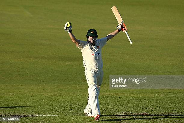 Alex Doolan of Tasmania celebrates after scoring his double century during day two of the Sheffield Shield match between Western Australia and...