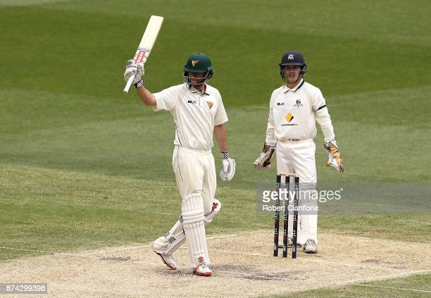 Alex Doolan of Tasmania celebrates after scoring his double century during day three of the Sheffield Shield match between Victoria and Tasmania at...