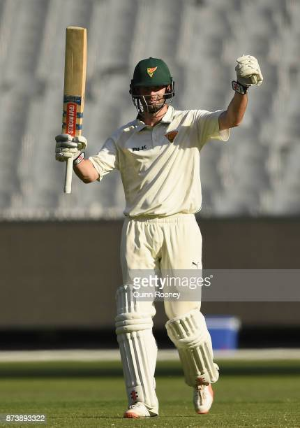 Alex Doolan of Tasmania celebrates making a century during day two of the Sheffield Shield match between Victoria and Tasmania at Melbourne Cricket...