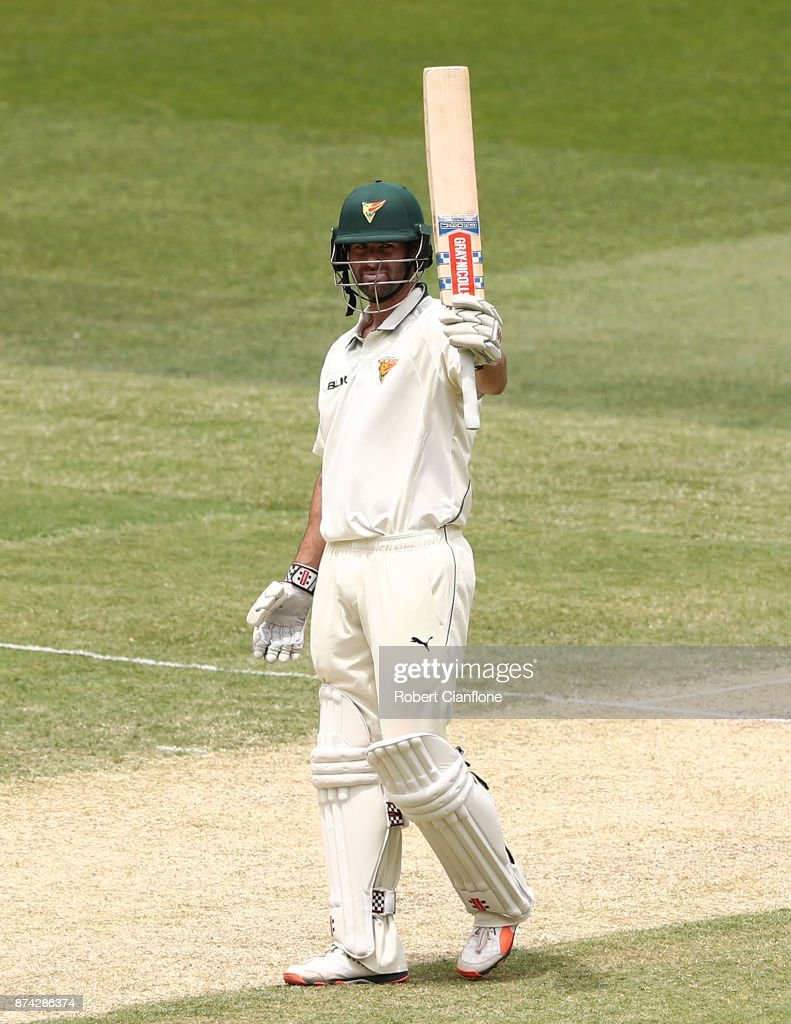 Alex Doolan of Tasmania raises his bat after scoring 150 runs during day three of the Sheffield Shield match between Victoria and Tasmania at Melbourne Cricket Ground on November 15, 2017 in Melbourne, Australia.
