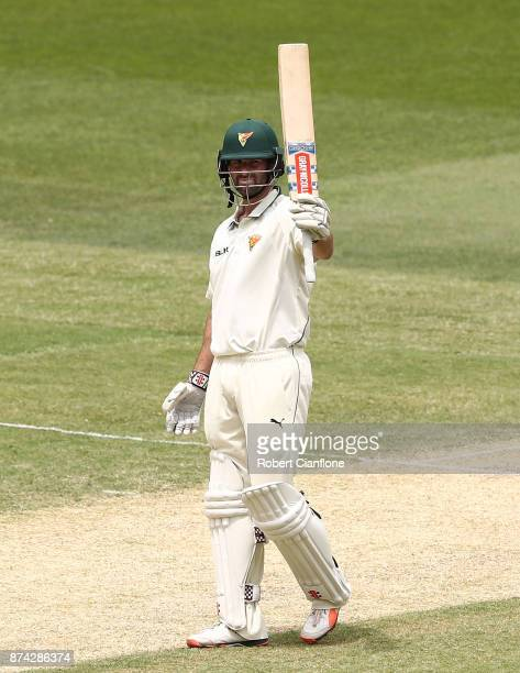 Alex Doolan of Tasmania raises his bat after scoring 150 runs during day three of the Sheffield Shield match between Victoria and Tasmania at...