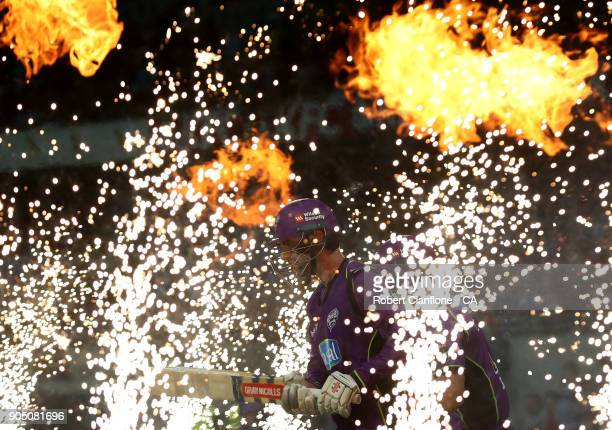 Alex Doolan of the Hurricanes makes his way out to bat during the Big Bash League match between the Hobart Hurricanes and the Brisbane Heat at...