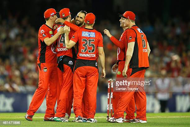 Alex Doolan of the Melbourne Renegades celebrates with team mates after taking a catch to dismiss Peter Forrest of the Brisbane Heat during the BIg...