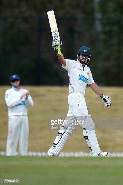 Alex Doolan of the Tigers celebrates his century during day four of the Sheffield Shield match between the New South Wales Blues and the Tasmania...