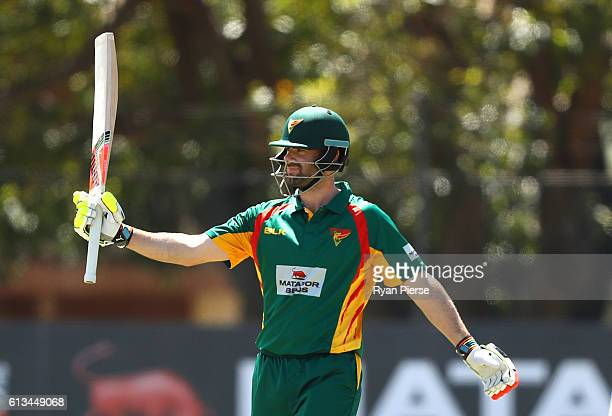 Alex Doolan of the Tigers celebrates reaching his half century during the Matador BBQs One Day Cup match between New South Wales and Tasmania at...