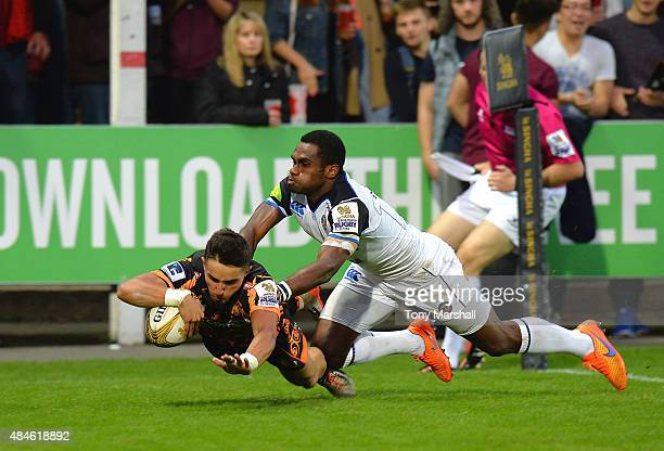 Alex Ducker of Exeter Chiefs scores a try as he is tackled by Apolosi Sokia of Bath Rugbyd uring the Singha Premiership Rugby 7s Series Gloucester at...