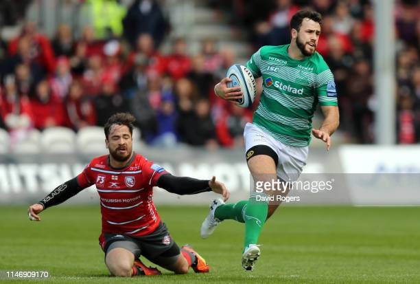 Alex Dunbar of Newcastle Falcons breaks away from Danny Cipriani of Gloucester Rugby during the Gallagher Premiership Rugby match between Gloucester...