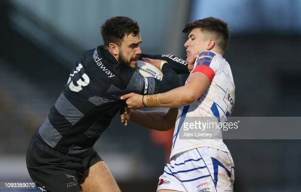 Alex Dunbar of Newcastle Falcons is tackled by Kieran Wilkinson of Sale Sharks during the Premiership Rugby Cup match between Sale Sharks and...