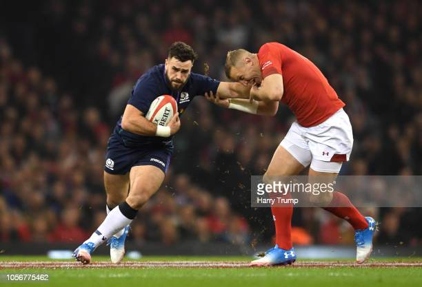 Alex Dunbar of Scotland breaks past Hadleigh Parkes of Wales during the International Friendly match between Wales and Scotland at the Principality...