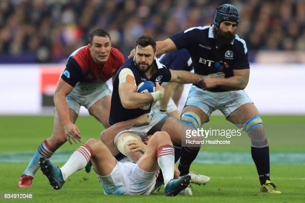 Alex Dunbar of Scotland is hauled down by the french defence during the RBS Six Nations match between France and Scotland at Stade de France on...