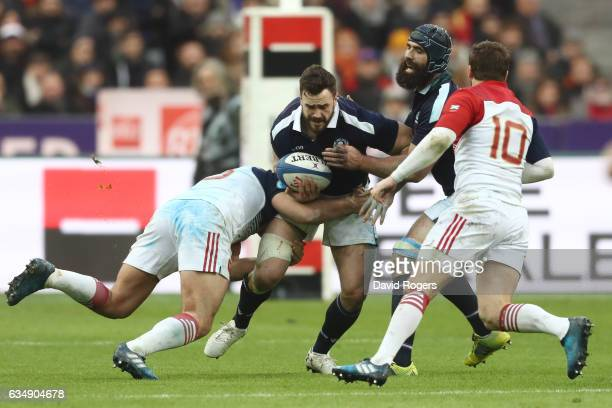 Alex Dunbar of Scotland is stopped during the RBS Six Nations match between France and Scotland at Stade de France on February 12, 2017 in Paris,...