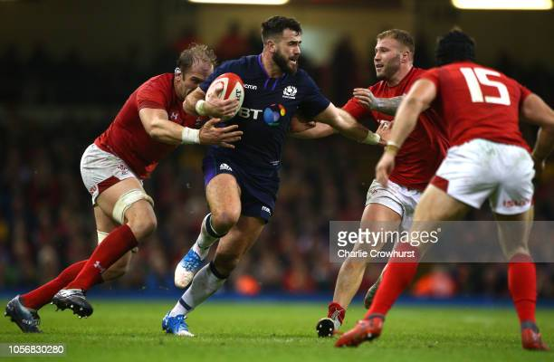Alex Dunbar of Scotland is tackled by Alun Wyn Jones and Ross Moriarty of Wales during the International Friendly match between Wales and Scotland at...