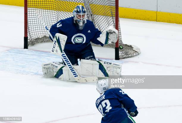 Alex Edler of the Vancouver Canucks shoots the puck on goalie Braden Holtby during a drill on the first day of the Vancouver Canucks NHL Training...