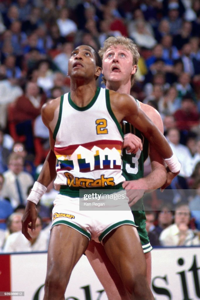 sports shoes e529d a7af1 Alex English of the Denver Nuggets boxes out Larry Bird of ...