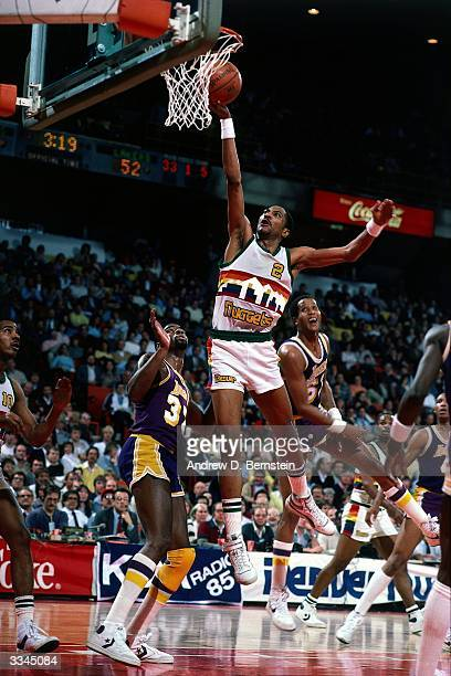Alex English of the Denver Nuggets goes for a layup against the Los Angeles Lakers during a 1983 game in Denver Colorado NOTE TO USER User expressly...