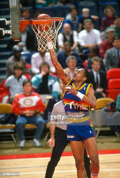 Alex English of the Denver Nuggets goes in for a layup against the Washington Bullets during an NBA basketball game circa 1988 at the Capital Centre...