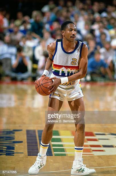 Alex English of the Denver Nuggets looks to pass during the NBA game at the McNichols Sports Arena circa 1986 in Denver Colorado NOTE TO USER User...