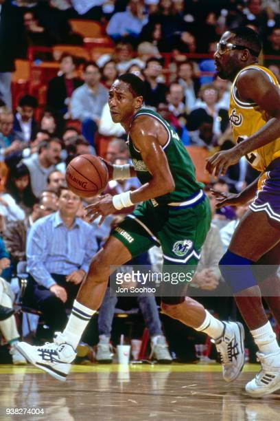 Alex English of the Milwaukee Bucks handles the ball against James Worthy of the Los Angeles Lakers circa 1990 at the Great Western Forum in...