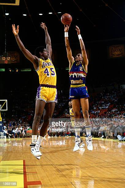 Alex English or the Denver Nuggets takes a jumper against the Los Angeles Lakers during an NBA game at the Forum in Los Angeles California NOTE TO...