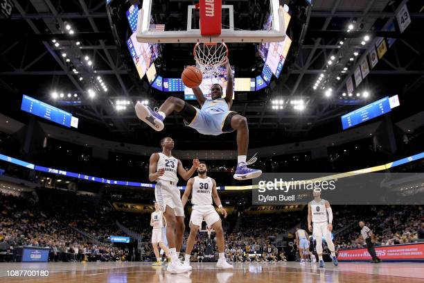 Alex Ennis of the Southern Jaguars dunks the ball in the first half against the Marquette Golden Eagles at the Fiserv Forum on December 28, 2018 in...