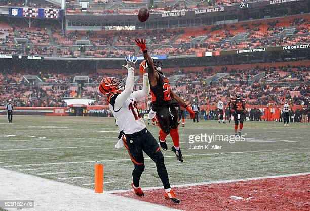 Alex Erickson of the Cincinnati Bengals can't make the catch against Briean BoddyCalhoun of the Cleveland Browns at Cleveland Browns Stadium on...