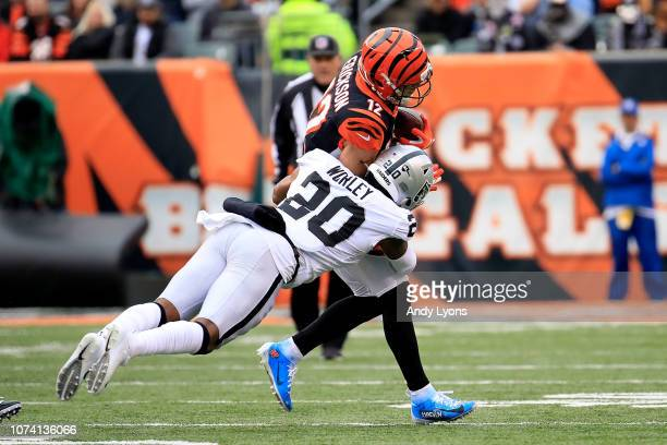 Alex Erickson of the Cincinnati Bengals is tackled by Daryl Worley of the Oakland Raiders during the third quarter at Paul Brown Stadium on December...
