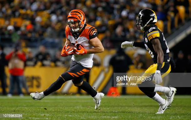 Alex Erickson of the Cincinnati Bengals runs upfield past Mike Hilton of the Pittsburgh Steelers after a catch in the first half during the game at...