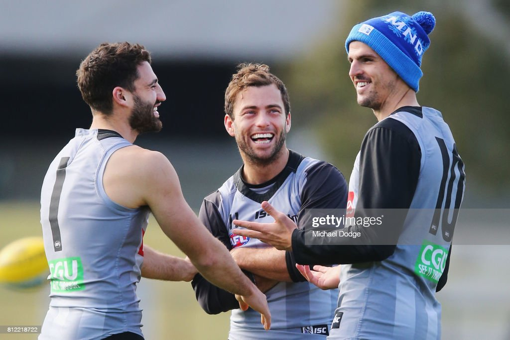 Alex Fasolo (L) Jarryd Blair (C) and Scott Pendlebury react during a Collingwood Magpies AFL training at the Holden Centre on July 11, 2017 in Melbourne, Australia.