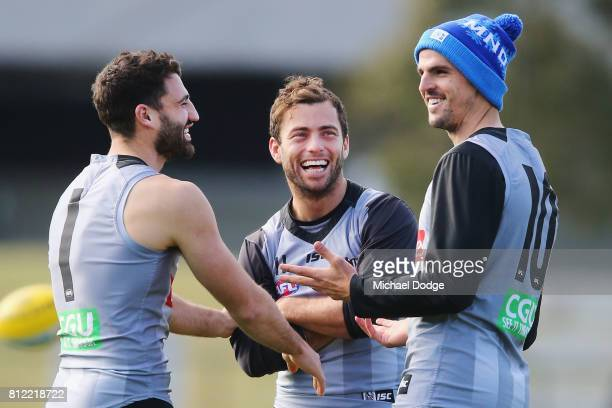 Alex Fasolo Jarryd Blair and Scott Pendlebury react during a Collingwood Magpies AFL training at the Holden Centre on July 11 2017 in Melbourne...