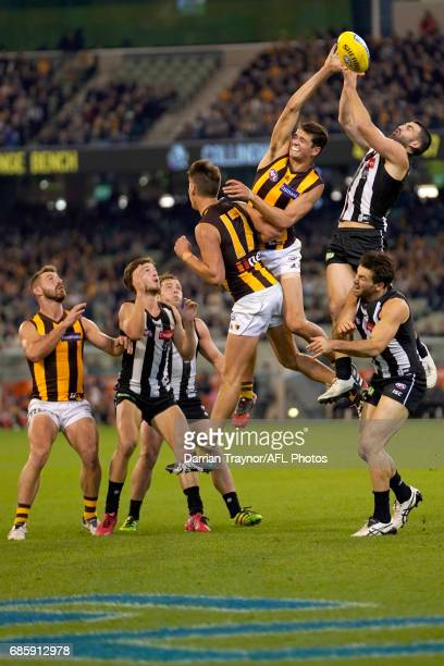 Alex Fasolo of the Magpies attempts to mark the ball during the round nine AFL match between the Collingwood Magpies and the Hawthorn Hawks at...
