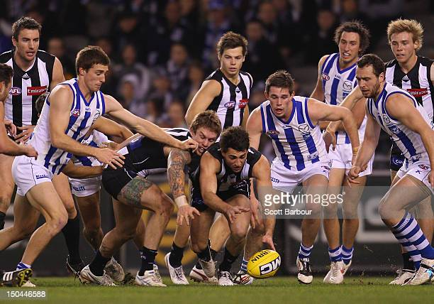 Alex Fasolo of the Magpies competes for the ball during the round 21 AFL match between the Collingwood Magpies and the North Melbourne Kangaroos at...