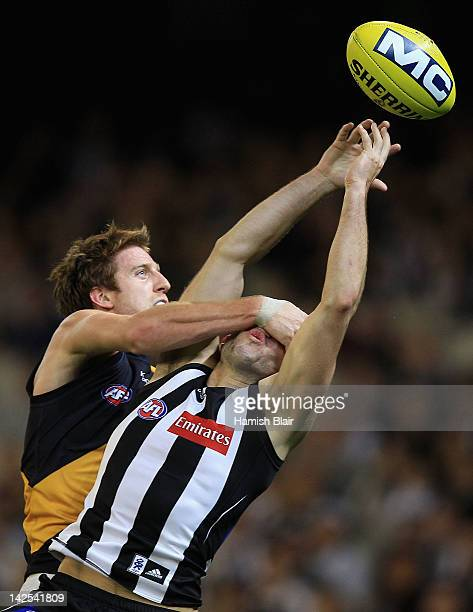 Alex Fasolo of the Magpies earns a free kick for high contact from Reece Conca of the Tigers during the round two AFL match between the Collingwood...