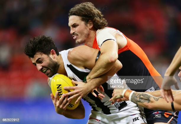 Alex Fasolo of the Magpies is tackled by Phil Davis of the Giants during the round eight AFL match between the Greater Western Sydney Giants and the...