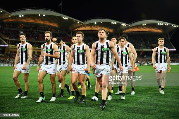 Alex Fasolo of the Magpies leads his team mates from the field after being defeated by the Power during the round 21 AFL match between Port Adelaide...