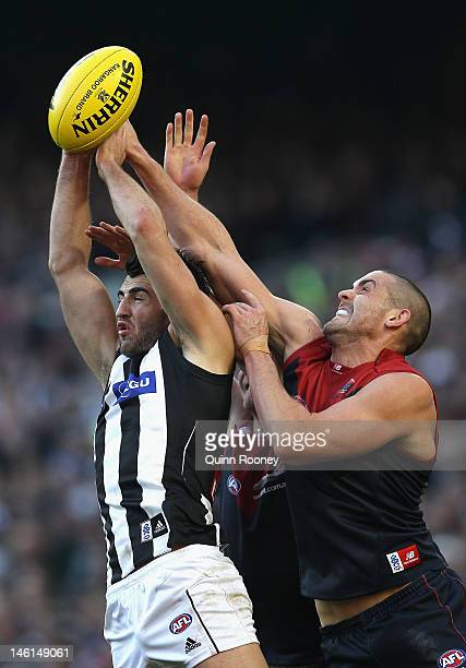 Alex Fasolo of the Magpies marks infront of James Sellar of the Demons during the round 11 AFL match between the Melbourne Demons and the Collingwood...