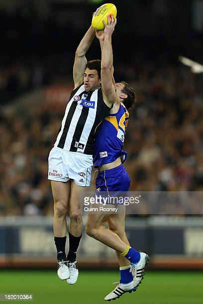 Alex Fasolo of the Magpies marks infront of Sam Butler of the Eagles during the first AFL Semi Final match between the Collingwood Magpies and the...
