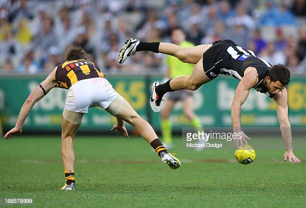 Alex Fasolo of the Magpies marks the ball against Liam Shiels of the Hawks during the round three AFL match between the Collingwood Magpies and the...