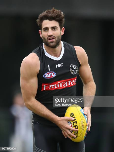 Alex Fasolo of the Magpies runs with the ball during a Collingwood Magpies AFL media session at the Holden Centre on May 11 2018 in Melbourne...