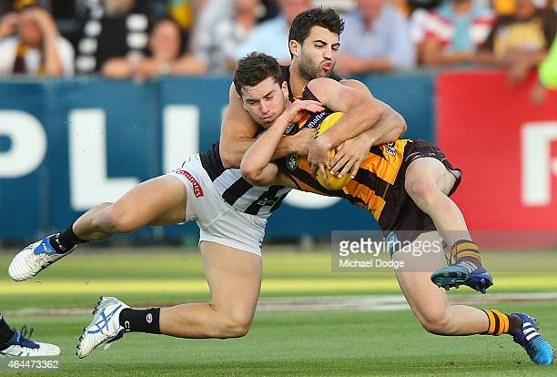 Alex Fasolo of the Magpies tackles Teia Miles of the Hawks during the NAB Challenge AFL match between Hawthorn Hawks and the Collingwood Magpies at...