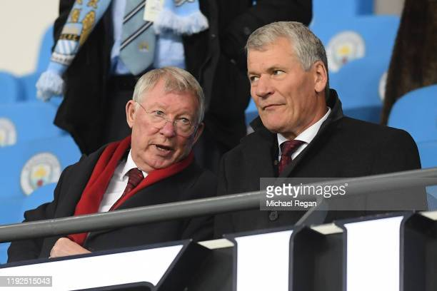 Alex Ferguson and David Gill look on prior to the Premier League match between Manchester City and Manchester United at Etihad Stadium on December...