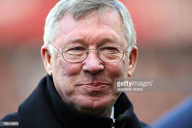 Alex Ferguson manager of Manchester United takes his seat prior to the Premier league football match against Everton at Old Trafford Manchester...