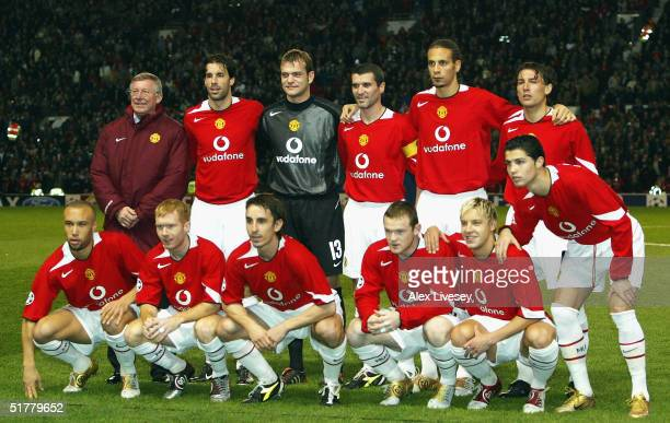 Alex Ferguson the manager of Manchester United joins his team line up for photographs before his 1000th game in charge against Olympique Lyon during...