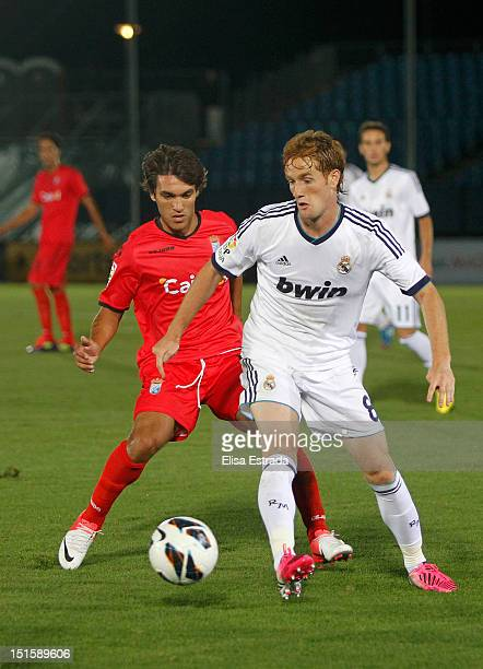 Alex Fernandez of Real Madrid gives a pass during the La Liga Adelante match between Real Madrid Castilla and Xerez at Estadio Alfredo Di Stefano on...