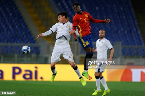 Alex Ferrari of Italy U21 ompete for the ball with Inaki Williams during the international friendly match between Italy U21 and Spain U21 at Olimpico...