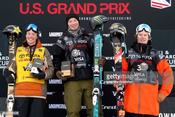 Alex Ferreira, David Wise and Aaron Blunck pose for photographers on the medals podium after the Men's Freeski Halfpipe final during the Toyota U.S....