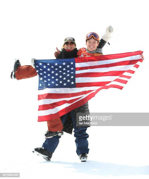 Alex Ferreira of United States is picked up by his coach Elana Chase after he wins silver in the Men's Ski Halfpipe at Phoenix Snow Park on February...