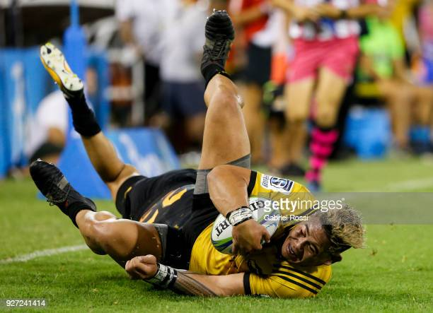 Alex Fidow of Hurricanes is tackled by Sebastian Cancelliere of Jaguares during a match between Jaguares and Hurricanes as part of third round of...