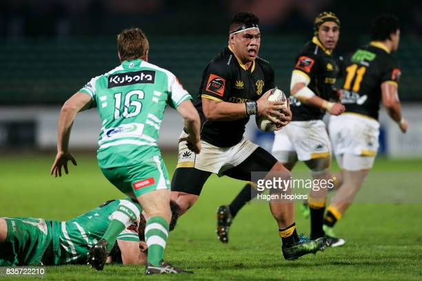 Alex Fidow of Wellington is tackled by Nick Crosswell of Manawatu during the round one Mitre 10 Cup match between Manawatu and Wellington at Central...